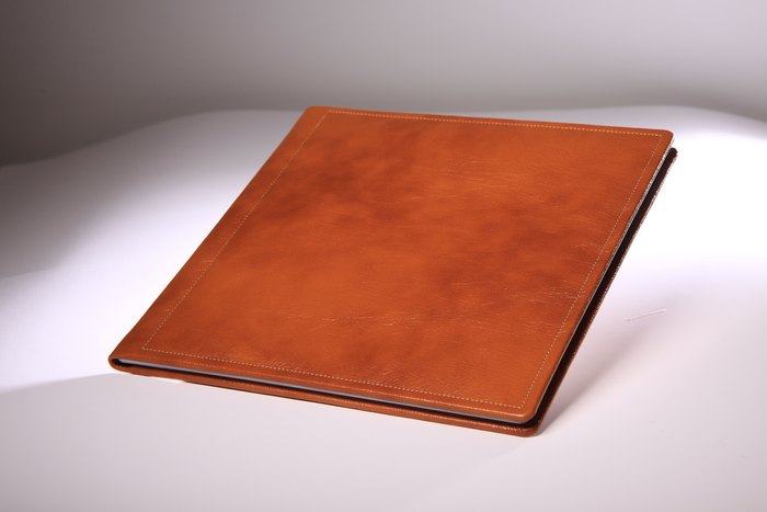 album with stitched leather cover